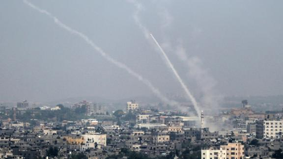 A picture taken on July 14, 2018 shows Palestinian rockets being fired from Gaza City towards Israel. - Israel