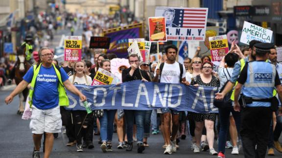 People march holding anti-Trump signs on Saturday in Edinburgh, Scotland.