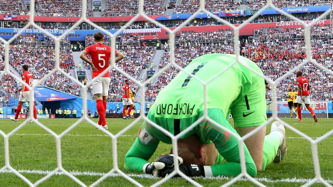 English goalkeeper Jordan Pickford reacts after the first goal against Belgium.