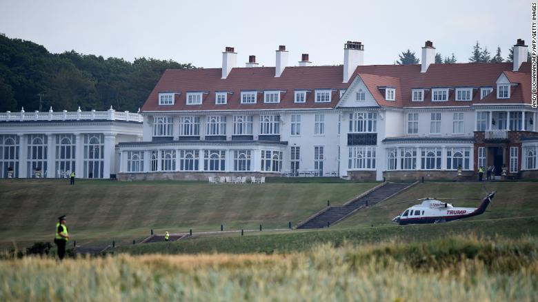 Police offficers stand guard at Trump Turnberry, the luxury golf resort of US President Donald Trump, in Turnberry, southwest of Glasgow, Scotland on July 14, 2018, during the private part of his four-day UK visit. - US President Donald Trump wraps up a four-day visit to Britain, dominated by his blasting of Prime Minister Theresa May's Brexit strategy, by spending the weekend in Scotland.
