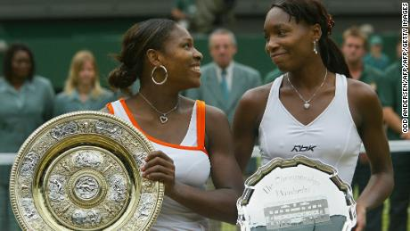 Serena Williams (L) of the US looks to her sister Venus Williams of the US after winning their Ladies Final match at the Wimbledon Tennis Championships 05 July, 2003 in Wimbledon, south London. Serena Williams won 4-6, 6-4, 6-2.   AFP PHOTO/Odd ANDERSEN  (Photo credit should read ODD ANDERSEN/AFP/Getty Images)