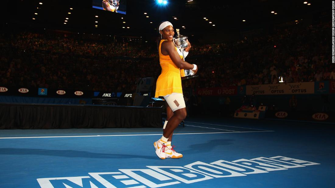 Serena poses with the Daphne Akhurst Trophy in 2010, her fifth Australian Open title.