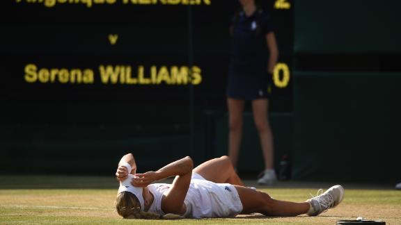 Kerber falls to the floor after her win