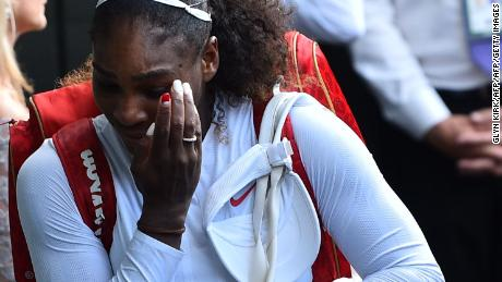 Williams leaves the court after losing to Germany's Kerber