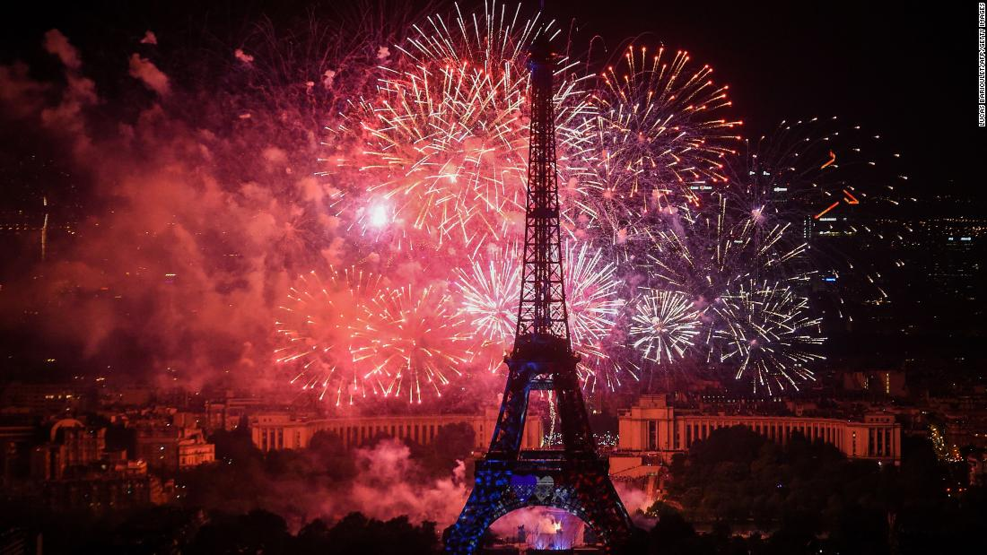 Bastille Day fireworks explode Saturday over the Eiffel Tower.