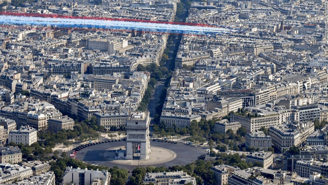 Aircraft fly over the Arc de Triomphe at the start of the annual Bastille Day military parade in Paris.