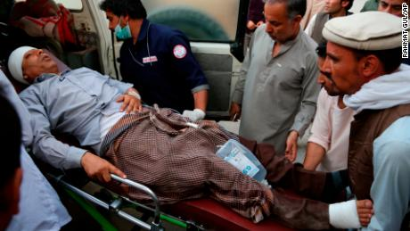 An injured man is put into an ambulance following a deadly attack in Kabul on Sunday.