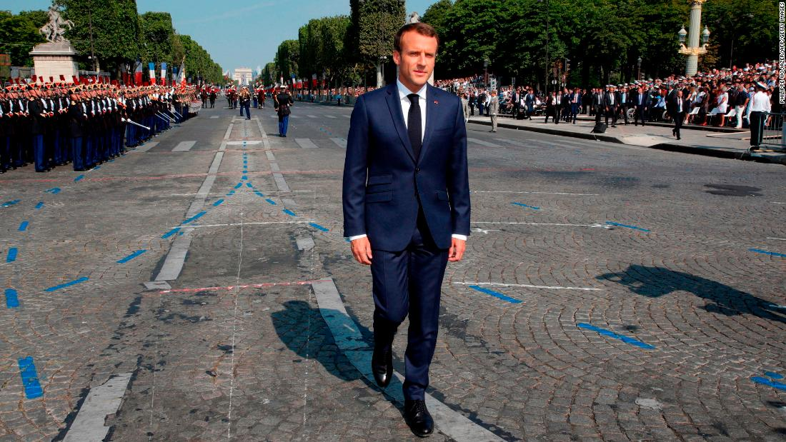 The French President arrives for the military parade.
