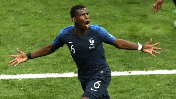 Paul Pogba, bottom, runs to the corner after scoring France