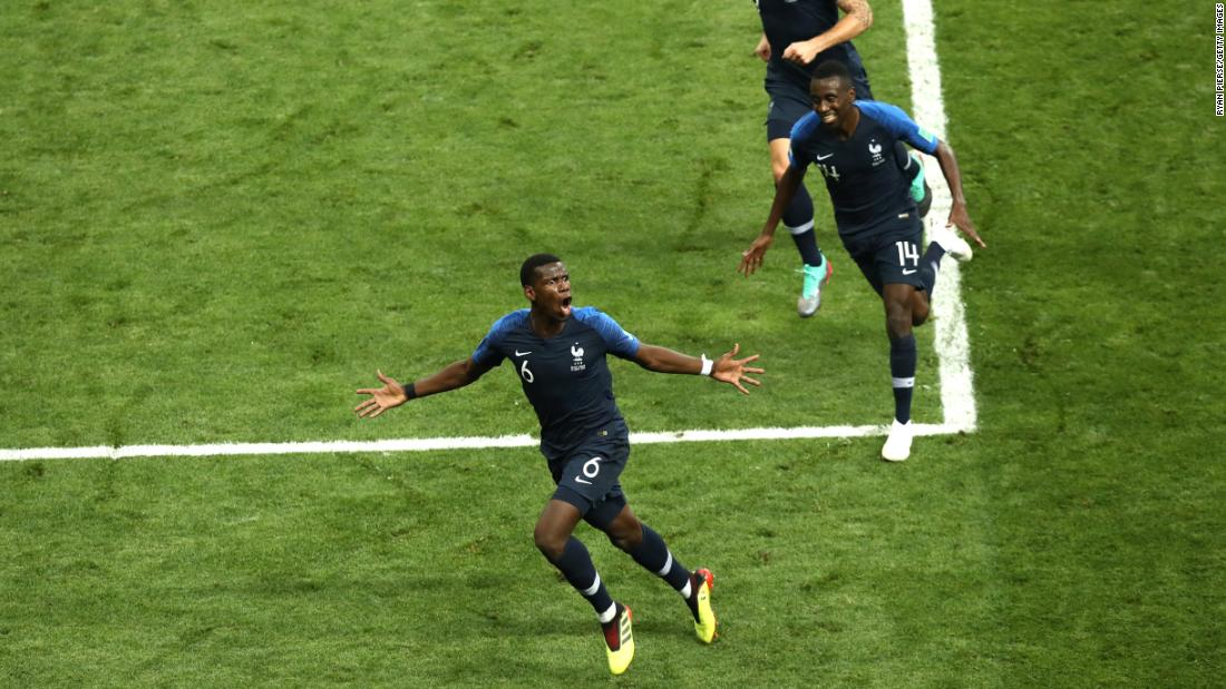 Paul Pogba, bottom, runs to the corner after scoring France's third goal.