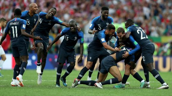 France mobs Kylian Mbappe after his goal gave the team a 4-1 lead.