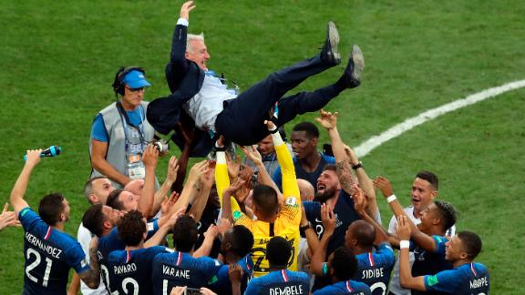 France manager Didier Deschamps is lifted by his players after the victory. Deschamps was also a player on the 1998 French team that won the World Cup.