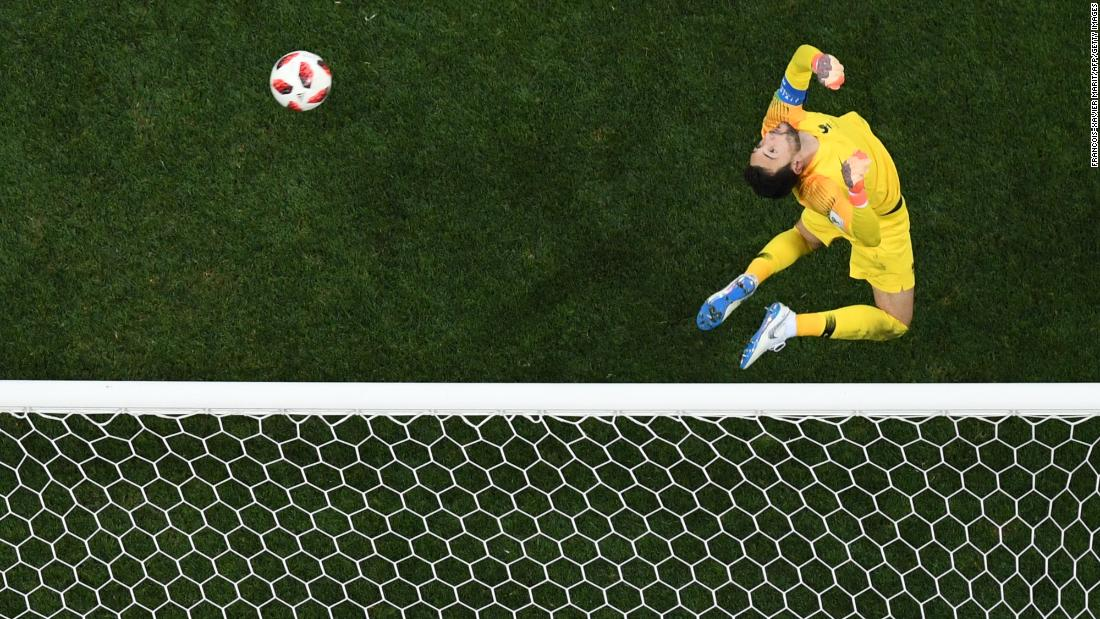 French goalkeeper Hugo Lloris makes a jumping save against Croatia.