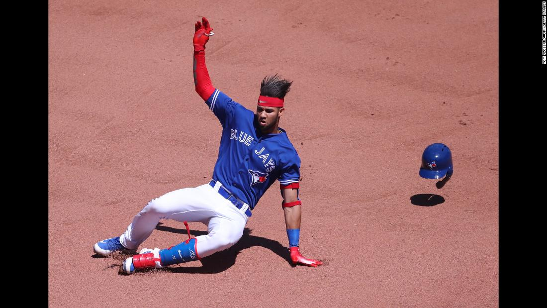 Lourdes Gurriel Jr. of the Toronto Blue Jays slides into second base as he hits a double in the seventh inning during an MLB game against the New York Yankees on Sunday, July 8, in Toronto, Canada. <br />