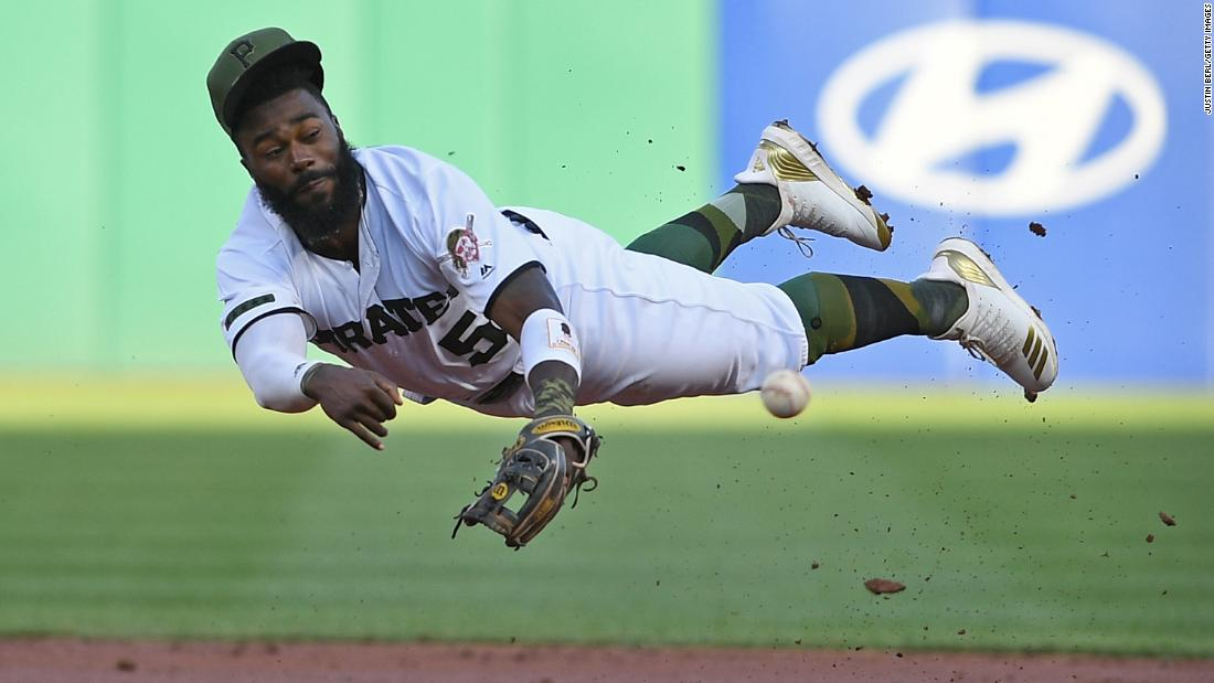 Josh Harrison of the Pittsburgh Pirates throws to first base in the second inning during the game against the Milwaukee Brewers on Thursday, July 12 in Pittsburgh.