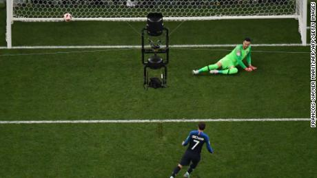 Griezmann (bottom) converts a penalty past Croatia's goalkeeper Danijel Subasic