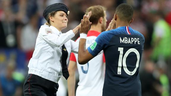 A pitch invader high fives Kylian Mbappe of France during the 2018 FIFA World Cup Final between France and Croatia on July 15, 2018 in Moscow, Russia.