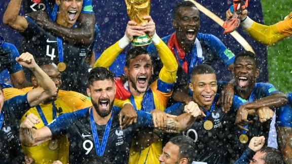 France's goalkeeper Hugo Lloris holds the trophy as he celebrates with teammates during the trophy ceremony at the end of the Russia 2018 World Cup final football match between France and Croatia at the Luzhniki Stadium in Moscow on July 15, 2018. (Photo by Alexander NEMENOV / AFP) / RESTRICTED TO EDITORIAL USE - NO MOBILE PUSH ALERTS/DOWNLOADS        (Photo credit should read ALEXANDER NEMENOV/AFP/Getty Images)