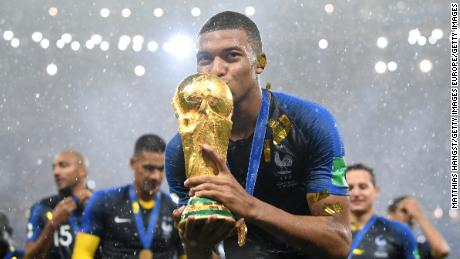 MOSCOW, RUSSIA - JULY 15:  Kylian Mbappe of France celebrates with the World Cup trophy following the 2018 FIFA World Cup Final between France and Croatia at Luzhniki Stadium on July 15, 2018 in Moscow, Russia.  (Photo by Matthias Hangst/Getty Images)