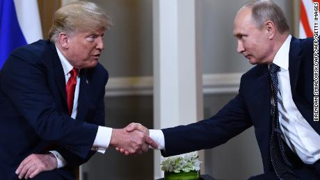 US President Donald Trump shakes hands with Russian President Vladimir Putin in front of Helsinki Summit in July 2018.