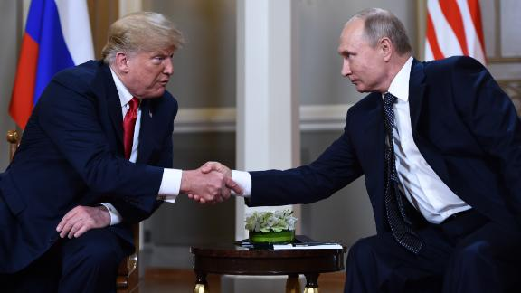 Russian President Vladimir Putin (R) and US President Donald Trump shake hands before a meeting in Helsinki, on July 16, 2018. (Photo by Brendan Smialowski / AFP)        (Photo credit should read BRENDAN SMIALOWSKI/AFP/Getty Images)