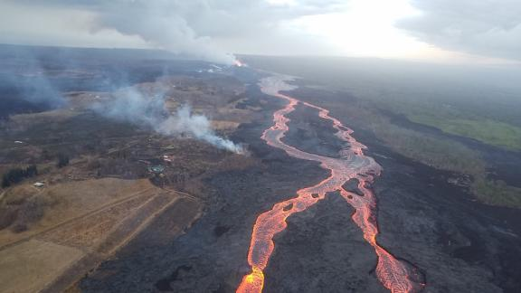 The braided lava channel extending from the fissure 8 vent (near top, center) and flowing toward the ocean.