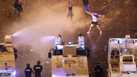 French riot police used water cannon trucks to disperse people on Champs-Elysees avenue.