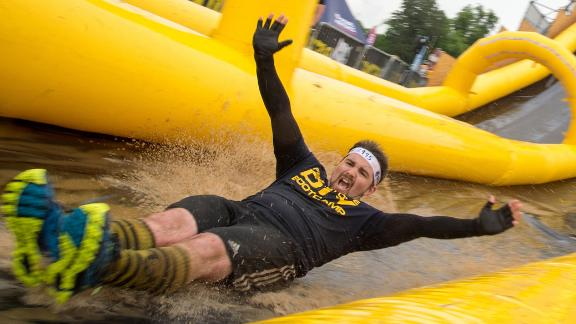 Most participants say their favorite obstacle is the last one: a 60-foot high water slide. Competitors barrel down the chute to a splashy end.