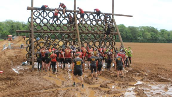 One section required pulling yourself through troughs of muddy water and then over a wall of tires.