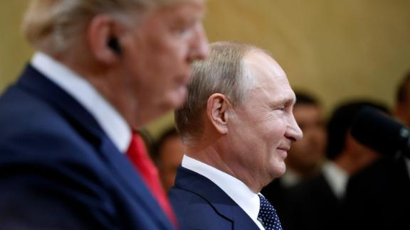 Russian President Vladimir Putin smiles during a press conference with U.S. President Donald Trump after the meeting of U.S. President Donald Trump and Russian President Vladimir Putin at the Presidential Palace in Helsinki, Finland, Monday, July 16, 2018. (AP Photo/Pablo Martinez Monsivais)