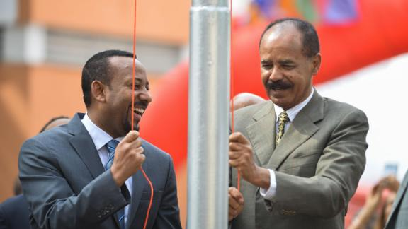 Ethiopian Prime Minister Abiy Ahmed (L) and President Isaias Afeworki of Eritrea (R) celebrate the reopening of the Embassy of Eritrea in Ethiopia as relations between both countries thaw.