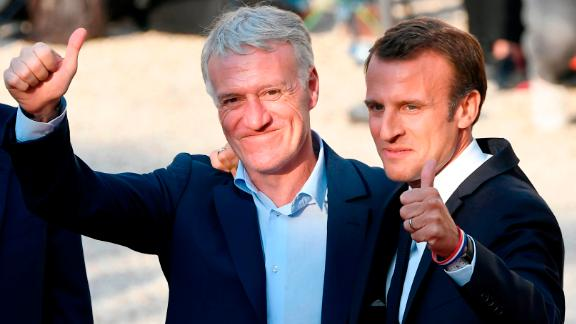 Macron poses with French coach Didier Deschamps (L) in Paris.