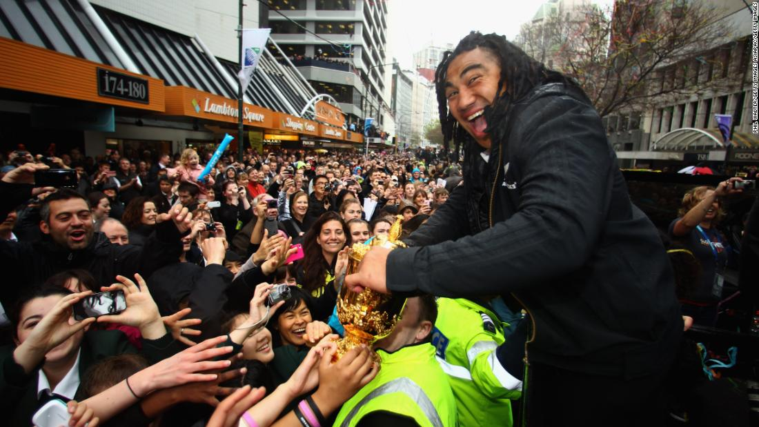 The All Blacks ended a 24-year drought when they lifted the Web Ellis trophy on home soil in 2011. Here, Ma'a Nonu greets raucous crowds during the victory parade in Wellington.