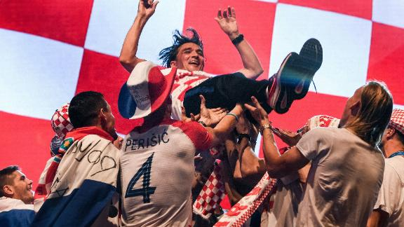 Croatian coach Zlatko Dalic is tossed  into the air by his  players during the welcoming ceremony.