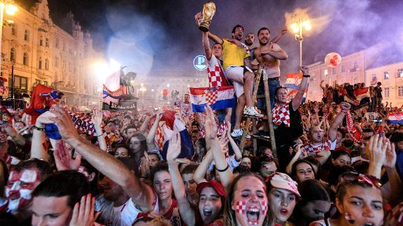 Supporters celebrate the arrival of Croatian team at the Bana Jelacica Square in Zagreb.