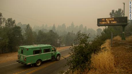 A fire transport drives along Highway 140, one of the entrances to Yosemite National Park.