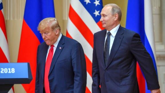 """US President Donald Trump (L) and Russia's President Vladimir Putin arrive to attend a joint press conference after a meeting at the Presidential Palace in Helsinki, on July 16, 2018. - The US and Russian leaders opened an historic summit in Helsinki, with Donald Trump promising an """"extraordinary relationship"""" and Vladimir Putin saying it was high time to thrash out disputes around the world. (Photo by Yuri KADOBNOV / AFP)        (Photo credit should read YURI KADOBNOV/AFP/Getty Images)"""