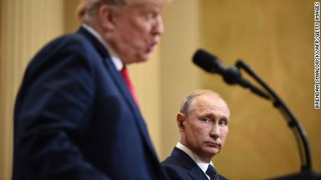 US President Donald Trump (L) and Russia's President Vladimir Putin attend a joint press conference after a meeting at the Presidential Palace in Helsinki, on July 16, 2018. - The US and Russian leaders opened an historic summit in Helsinki, with Donald Trump promising an