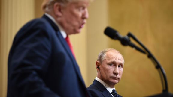 "US President Donald Trump (L) and Russia's President Vladimir Putin attend a joint press conference after a meeting at the Presidential Palace in Helsinki, on July 16, 2018. - The US and Russian leaders opened an historic summit in Helsinki, with Donald Trump promising an ""extraordinary relationship"" and Vladimir Putin saying it was high time to thrash out disputes around the world. (Photo by Brendan SMIALOWSKI / AFP)        (Photo credit should read BRENDAN SMIALOWSKI/AFP/Getty Images)"