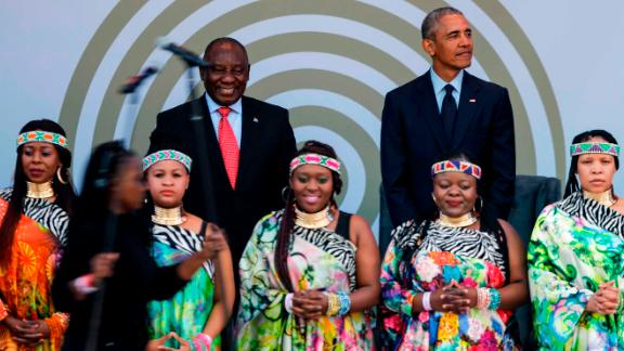 Former US President Barack Obama, right, with South African President Cyril Ramaphosa standing behind the Soweto Gospel Choir.