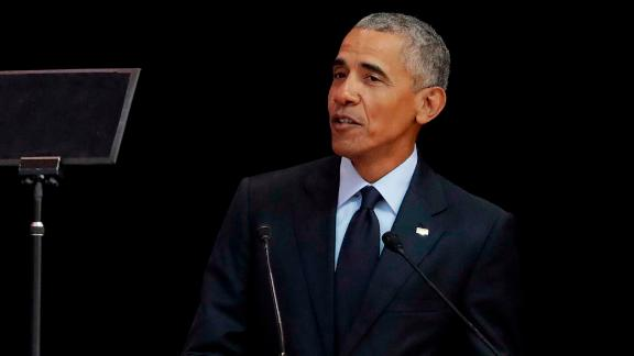 Former U.S. President Barack Obama, left, delivers his speech at the 16th Annual Nelson Mandela Lecture at the Wanderers Stadium in Johannesburg, South Africa, Tuesday, July 17, 2018. In his highest-profile speech since leaving office, Obama urged people around the world to respect human rights and other values under threat in an address marking the 100th anniversary of anti-apartheid leader Nelson Mandela