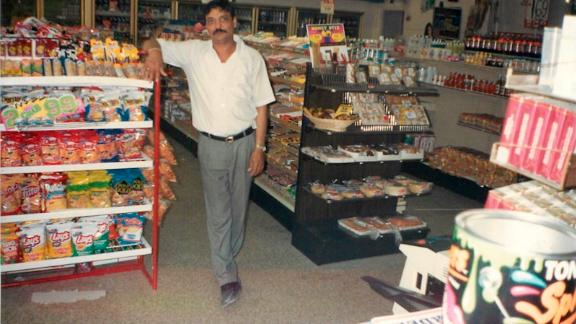 Hasmukh Patel, who was killed in 2004, stands inside his food mart.