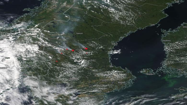 NASA MODIS satellite image shows multiple large fires (in red) burning in central and southern Sweden on Tuesday, spreading smoke for hundreds of kilometers across Scandinavia.