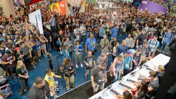 Connie Nielsen, Chris Pine, Gal Gadot and director Patty Jenkins from the 2017 feature film 'Wonder Woman' sign autographs for fans in DC's 2016 San Diego Comic-Con booth.