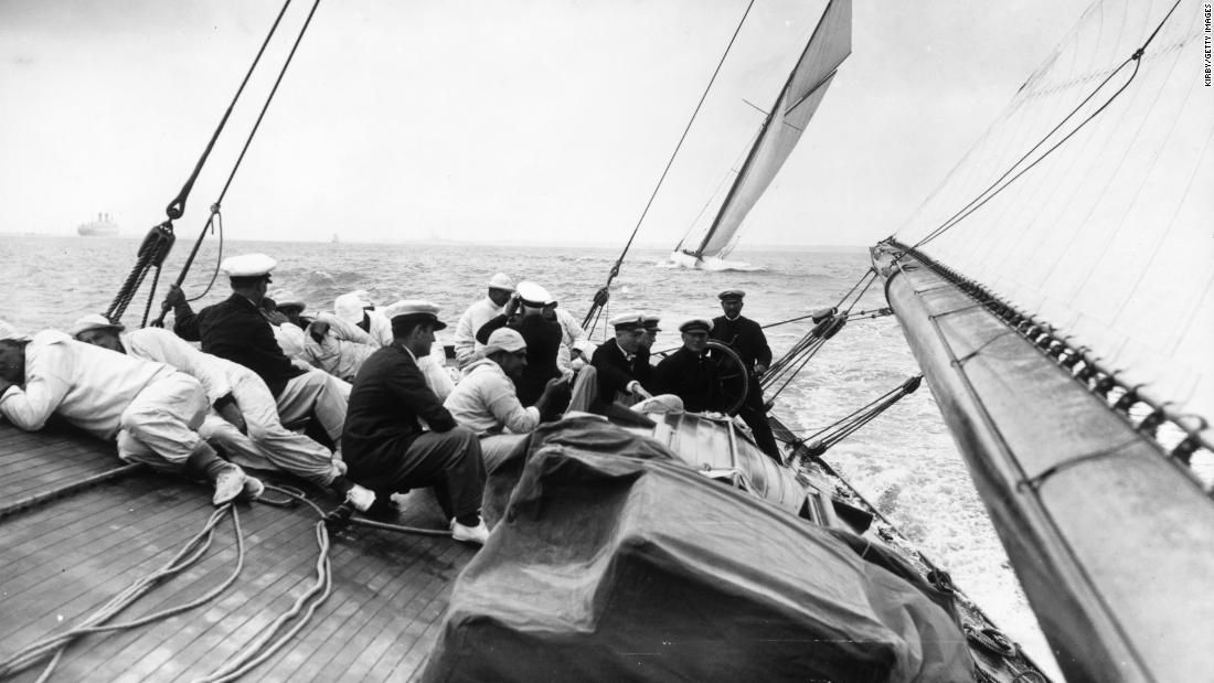 "As many as 8,000 competitors take part -- from Olympic and world class yachtsmen to weekend sailors. Pictured here is the crew of the ""Shamrock"" lying close to the deck to reduce drag as the yacht sails close to the wind."