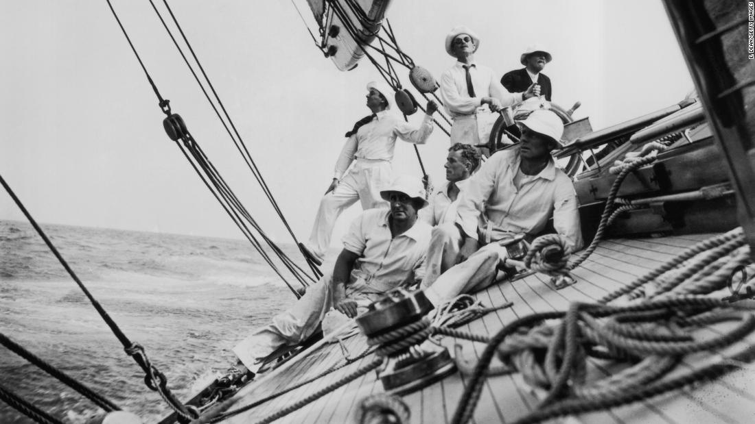 Pictured here in 1935 is the crew of 'Candida' steering the yacht along a heavily inclined wave during a race.
