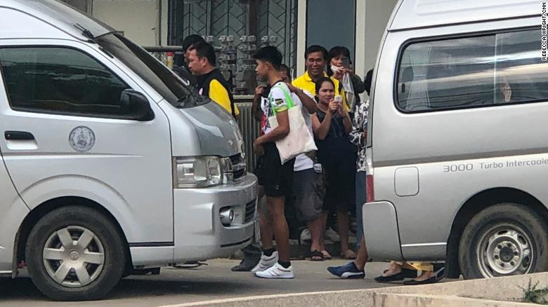 Some of the boys who were trapped in a cave in Northern Thailand outside a hospital in Chiang Rai after being discharged.