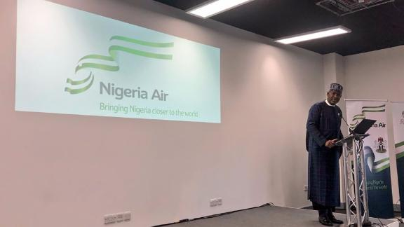 Nigerian Minister of State for Aviation, Hadi Sirika unveils the name and logo of Nigeria's new national airline at the Farnborough International Air Show in London on July 18, 2018.