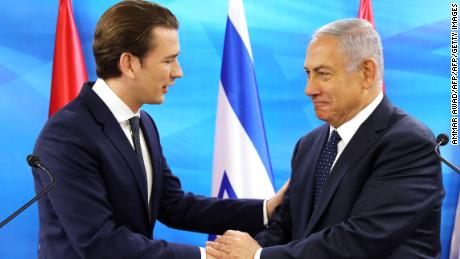Netanyahu and Austrian Chancellor Sebastian Kurz shake hands during a joint press conference with the Prime Minister