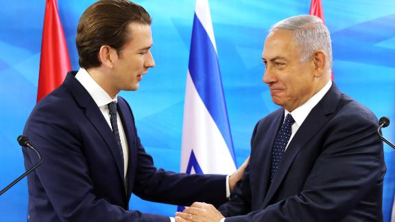 Netanyahu and Austrian Chancellor Sebastian Kurz shake hands during a joint press conference at the prime minister